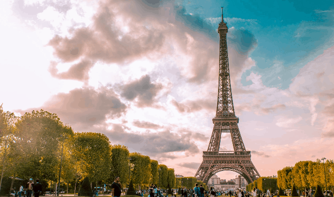 A Large Group Of Tourists Near Eiffel Tower In Paris